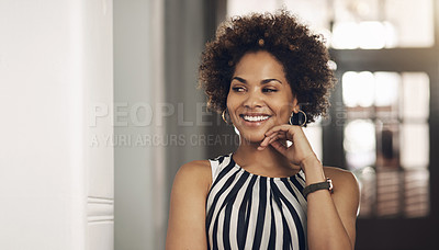 Buy stock photo Shot of a young businesswoman looking thoughtful in a modern office