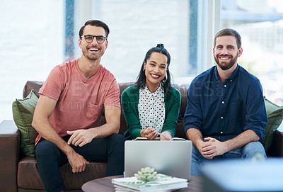 Buy stock photo Portrait of a group of young businesspeople using a laptop together in a modern office