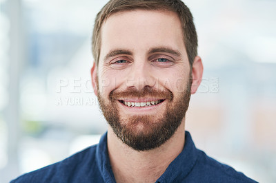 Buy stock photo Portrait of a confident young businessman working in a modern office