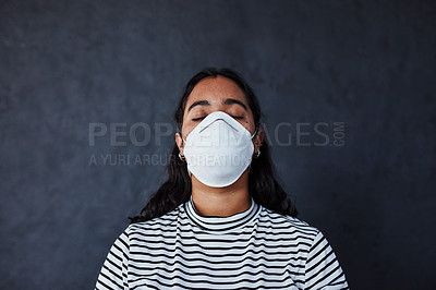 """Buy stock photo Studio shot of a young woman wearing a mask with """"I can't breathe"""" in protest against racism"""