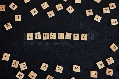 "Buy stock photo Studio shot of a wooden tiles with letters spelling out ""Equality"" against a black background"