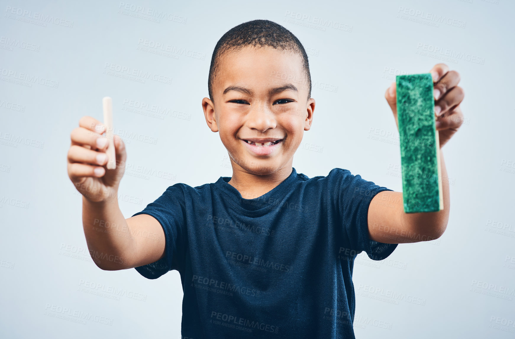 Buy stock photo Studio shot of a cute little boy chalk and a duster against a grey background