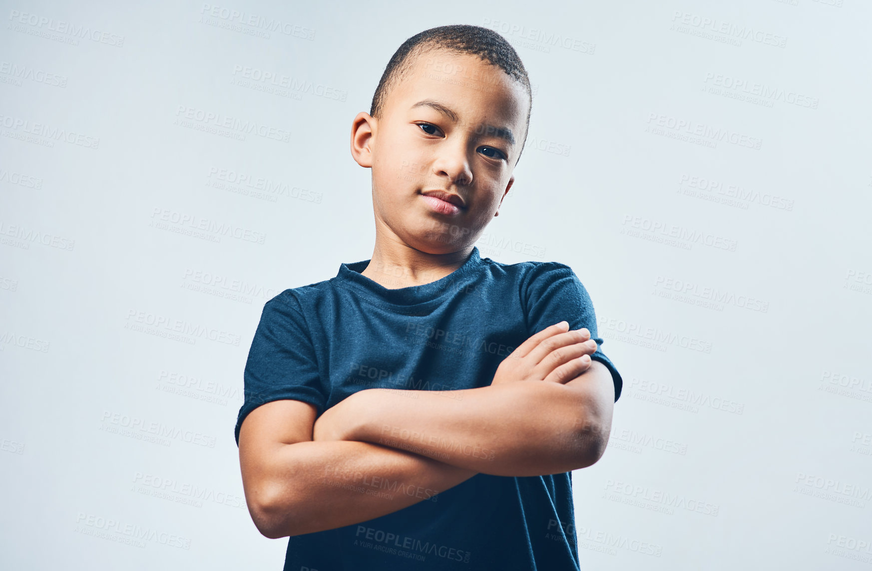 Buy stock photo Studio shot of a cute little boy posing confidently against a grey background
