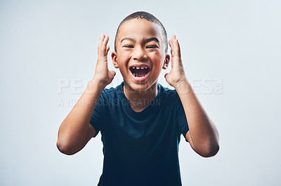 Buy stock photo Studio shot of a cute little boy looking amazed against a grey background