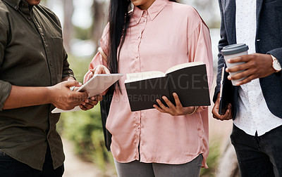 Buy stock photo Shot of a group of businesspeople having a meeting while walking through the city