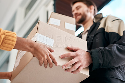 Buy stock photo Shot of a young man delivery a package to a woman at home