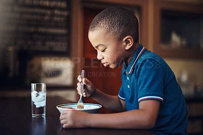 Buy stock photo Cropped shot of a young boy eating a bowl of spaghetti at home
