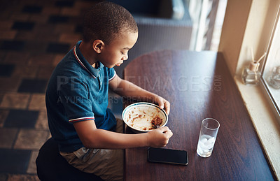 Buy stock photo Shot of a young boy eating a bowl of spaghetti at home