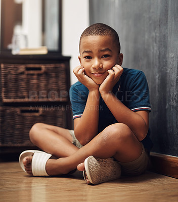 Buy stock photo Shot of an adorable little boy sitting at home