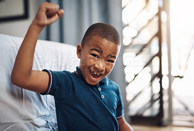 Buy stock photo Shot of a young boy looking cheerful while sitting at home