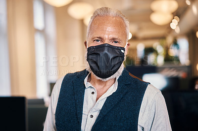 Buy stock photo Cropped portrait of a handsome mature businessman standing in his office while wearing a mask