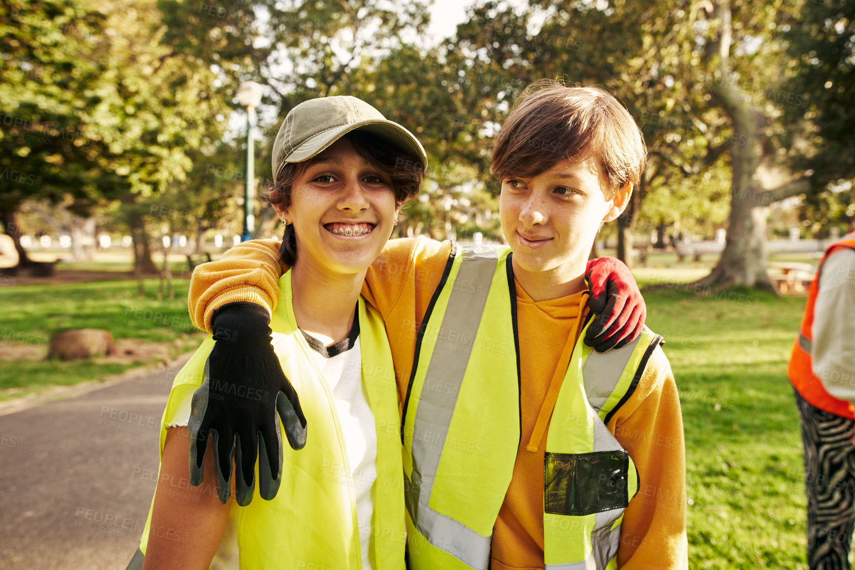 Buy stock photo Cropped portrait of two young female volunteers doing community service in their local park