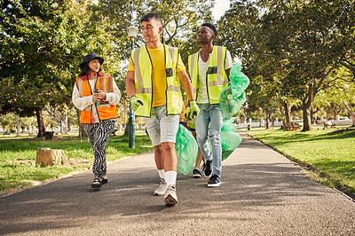 Buy stock photo Full length shot of a group of young volunteers doing community service in their local park