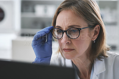 Buy stock photo Shot of mature scientist working on a computer in a lab