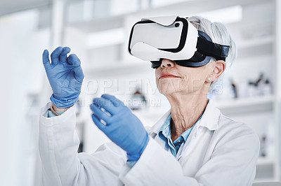 Buy stock photo Shot of a mature scientist wearing a VR headset in a lab