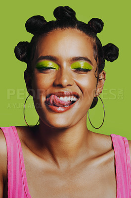 Buy stock photo Shot of a woman posing against a green background with her bantu knots