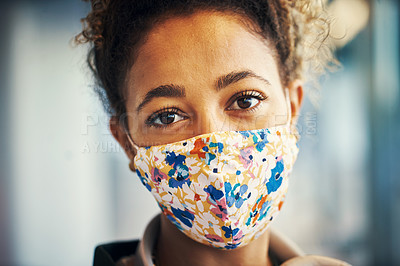 Buy stock photo Shot of a masked young woman travelling through a subway station