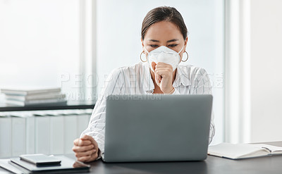 Buy stock photo Shot of a masked young businesswoman coughing while working at her desk in a modern office