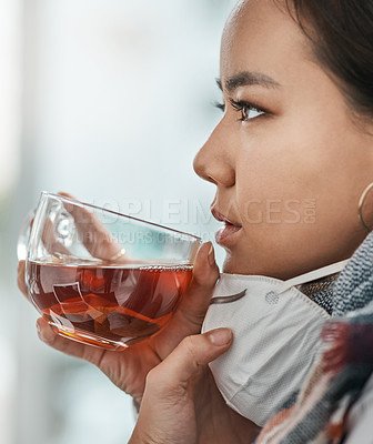Buy stock photo Shot of a young businesswoman having a glass of herbal tea in a modern office