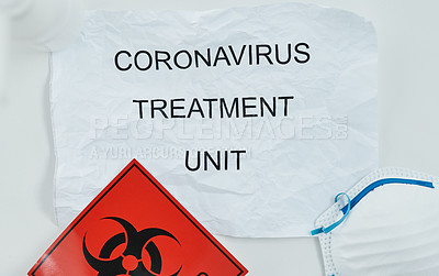 Buy stock photo Shot of a biohazard sign, a face mask and a sign saying
