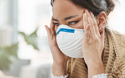 Buy stock photo Cropped shot of a woman wearing a mask while looking stressed at home