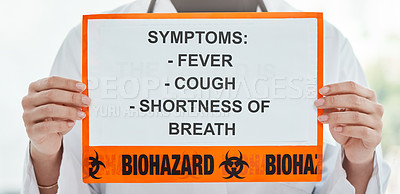 Buy stock photo Cropped shot of a doctor holding a sign with a list of COVID-19 symptoms on it