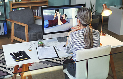 Buy stock photo Shot of a young man having a counselling session with a psychologist using a video conferencing tool