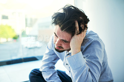Buy stock photo Shot of a young man suffering from a mental breakdown