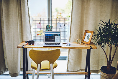 Buy stock photo Shot of a laptop on a desk in a home office