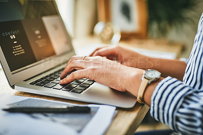 Buy stock photo Closeup shot of an unrecognisable woman using a laptop at home