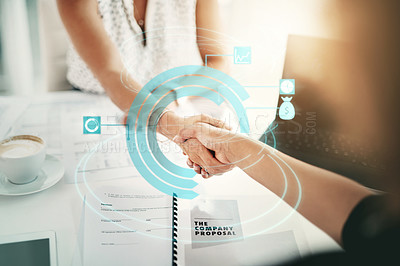 Buy stock photo Cropped shot of two unrecognizable businesswomen shaking hands in an office superimposed with cgi special effects