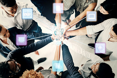Buy stock photo High angle shot of a group of unrecognizable businesspeople joining their hands together in a huddle superimposed with cgi special effects