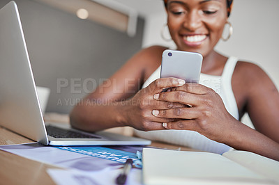 Buy stock photo Closeup shot of a young woman using a cellphone and laptop while working from home