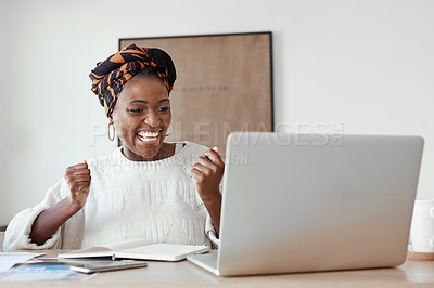 Buy stock photo Shot of a young woman cheering while working on a laptop at home