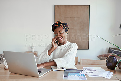 Buy stock photo Shot of a young woman talking on a cellphone while working on a laptop at home