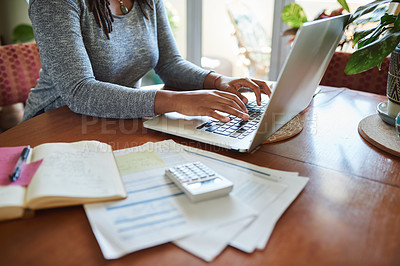 Buy stock photo Cropped shot of a woman using a laptop while working from home