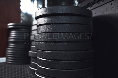 Buy stock photo Still life shot of weight plates in a gym