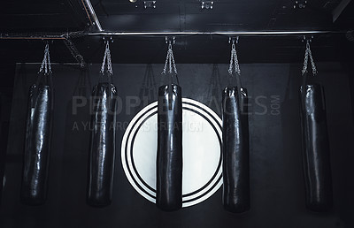 Buy stock photo Still life shot of a row of punching bags in a gym