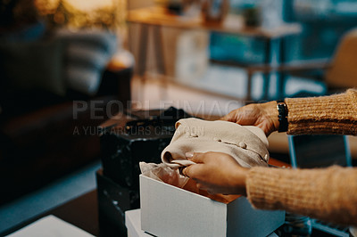 Buy stock photo Closeup shot of an unrecognisable designer packing clothing into a box