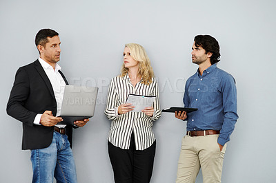 Buy stock photo Studio shot of a group of businesspeople having a discussion against a grey background