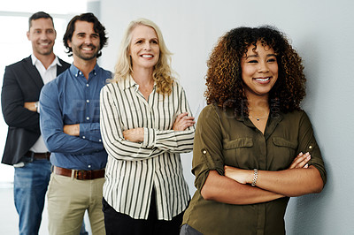 Buy stock photo Shot of a group of businesspeople standing in line in a modern office