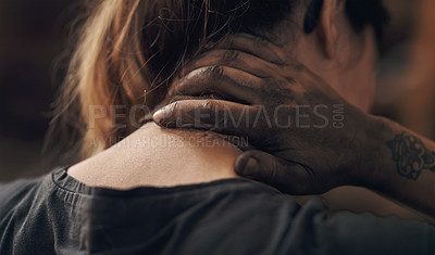 Buy stock photo Shot of a young woman experiencing neck pain while working at a foundry