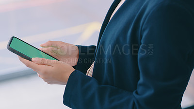 Buy stock photo Cropped shot of an unrecognizable businesswoman using a smartphone