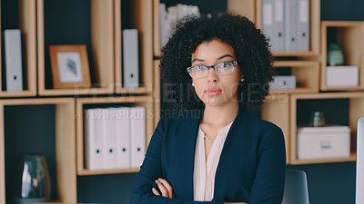 Buy stock photo Cropped shot of a young businesswoman standing in an office