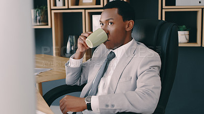 Buy stock photo Shot of a businessman drinking coffee while sitting at his desk