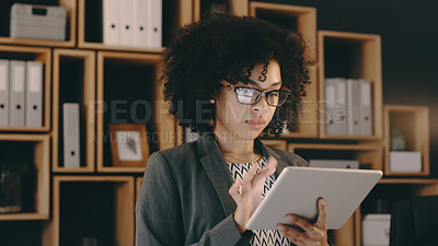 Buy stock photo Cropped shot of a businesswoman using a digital tablet at the office