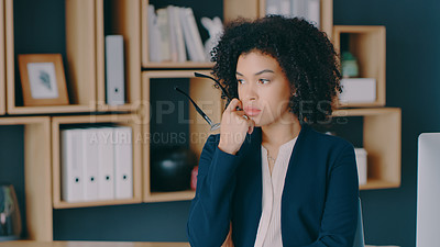 Buy stock photo Shot of a young businesswoman looking thoughtful