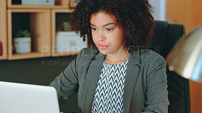 Buy stock photo Cropped shot of a businesswoman using a laptop while sitting at her desk