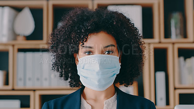 Buy stock photo Cropped shot of a young businesswoman wearing a mask at the office
