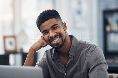 Buy stock photo Portrait of a young businessman working in an office